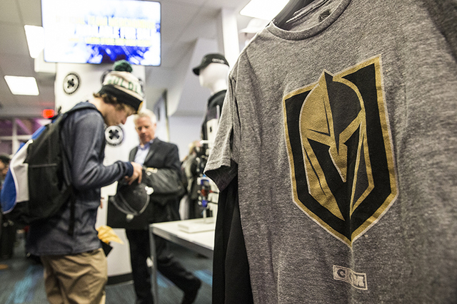 (Benjamin Hager/Las Vegas Review-Journal Fans purchase official Golden Knights merchandise at the conclusion of a ceremony to unveil the Las Vegas' NHL expansion franchise's official team nickname ...