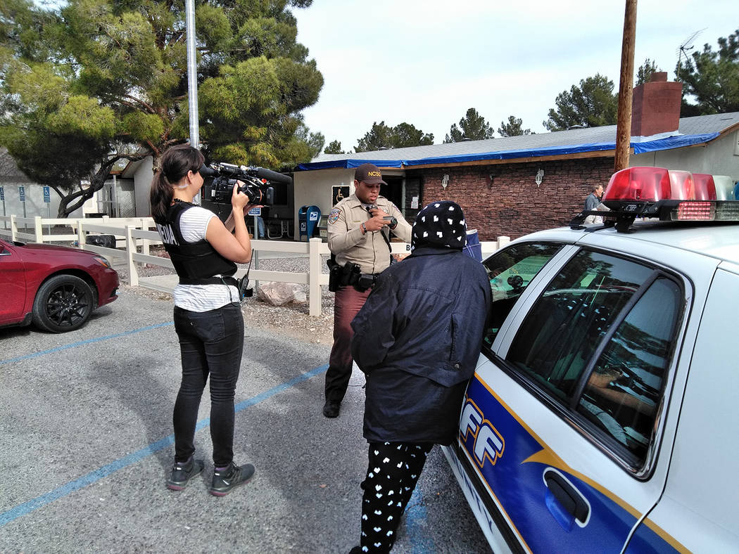 Selwyn Harris/Pahrump Valley Times A 'Live PD' crew member films a Nye County Sheriff's deputy during a service call last week. The popular program on the A&E Channel is spotlighting law enfor ...