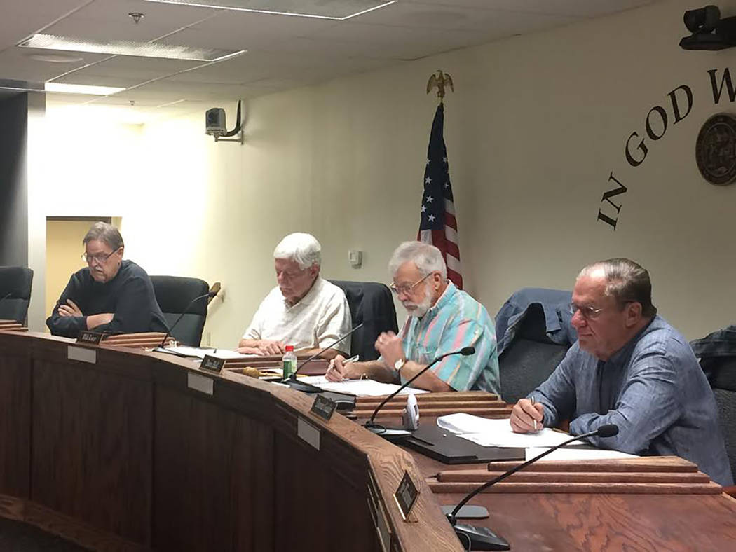 Robin Hebrock/Pahrump Valley Times Pictured from right to left are Nye County Water District Governing Board members Dennis Gaddy, Dave Hall, Walt Kuver and William Knecht, four of the seven-membe ...