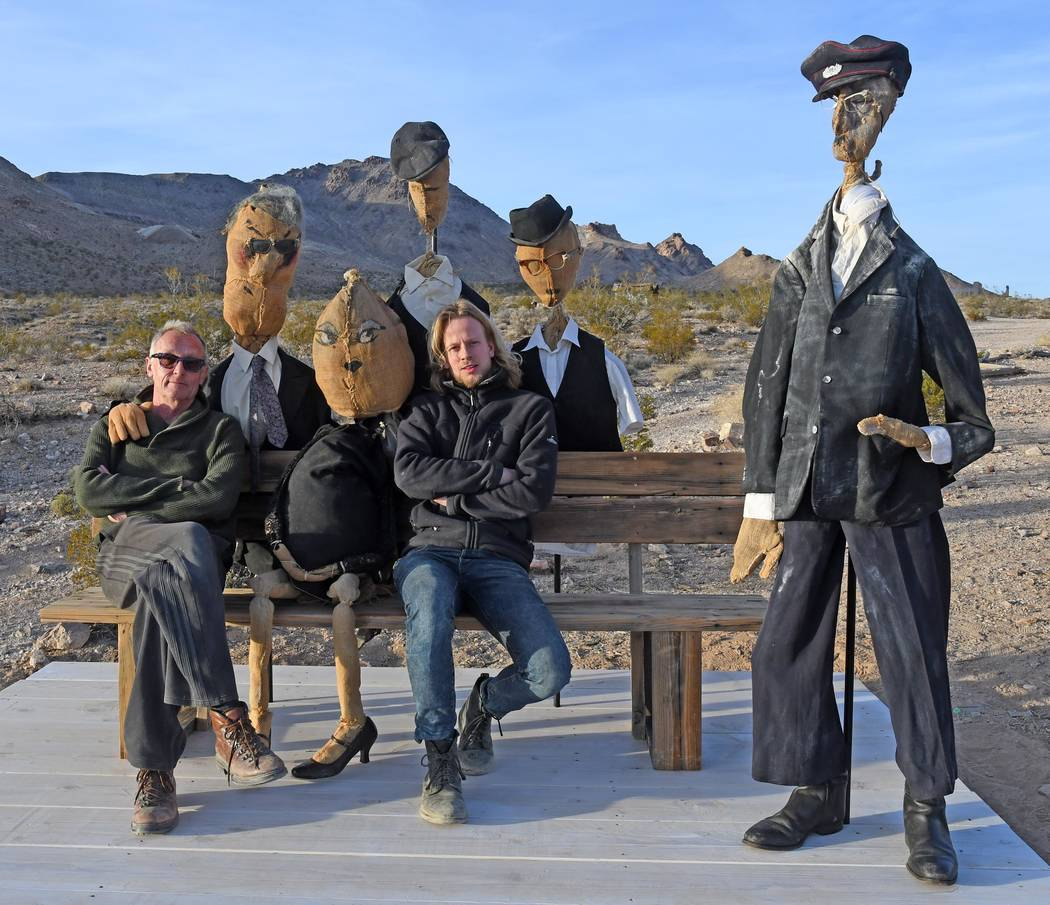 Richard Stephens/Special to the Pahrump Valley Times Dutch artist Onny Huisink, left, and his young carpenter, Koen Broersen, sit with the puppets. The artist says the crudeness of the puppets is  ...
