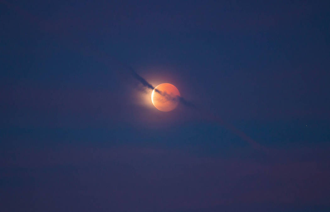 National Park Service A look at the eclipse early Wednesday at Death Valley National Park. The super blue moon passed through Earth's shadow, taking on a reddish tint.
