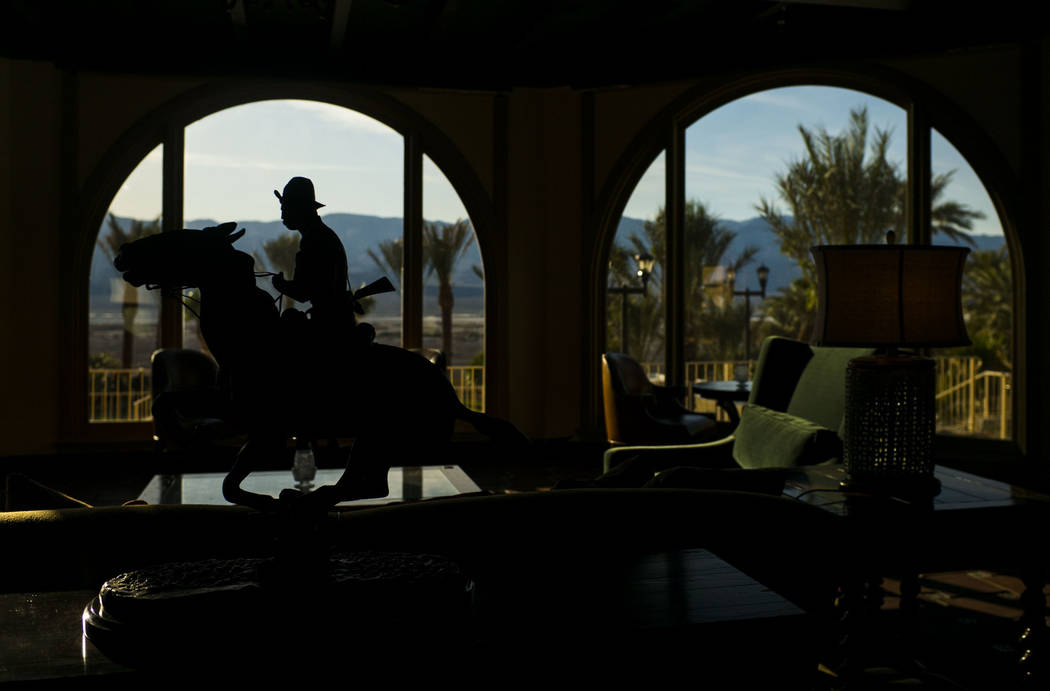 A sculpture is silhouetted against a view looking out over the valley during a tour of The Inn at Death Valley in Death Valley National Park, Calif, on Tuesday, Jan. 23, 2018. The Inn, formerly th ...