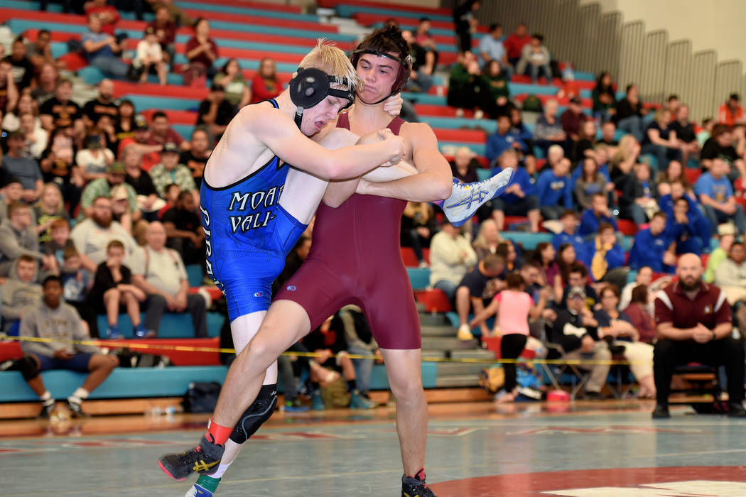 Peter Davis/Special to the Pahrump Valley Times Dylan Grossell, at 138 pounds and in the maroon uniform, is shown competing in the regional wrestling championship this past week. He is advancing t ...