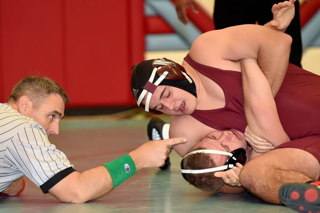 Peter Davis/Special to the Pahrump Valley Times Morgan White of Pahrump Valley High School is shown gaining the upper hand on an opponent at the regional championships. The Trojans competed in the ...