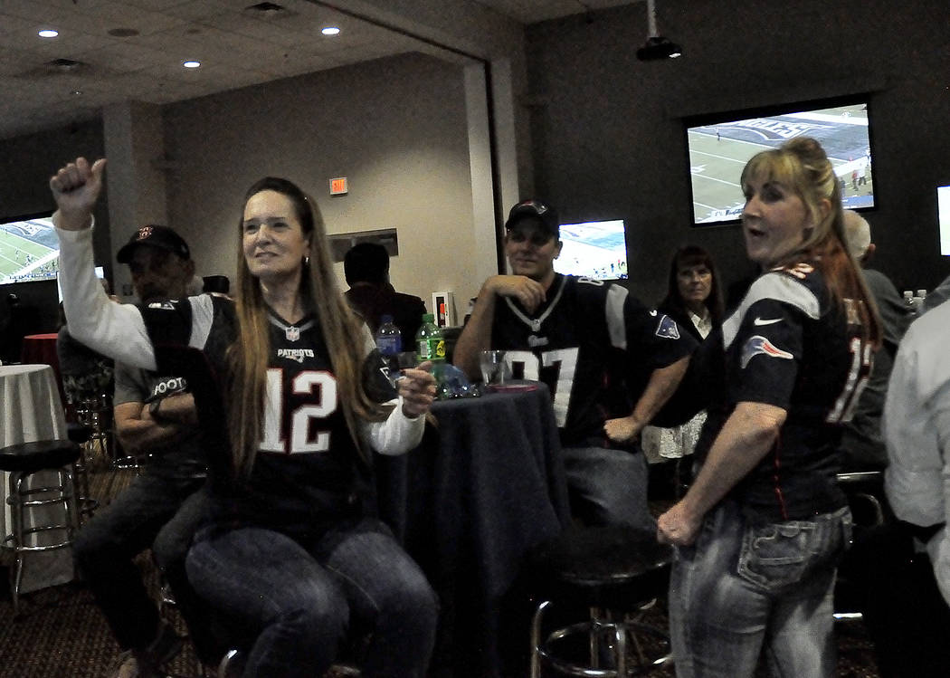 Horace Langford Jr./Pahrump Valley Times  New England Patriot fans Anita Hilling, Jason Hilling and Vicky Hilling cheer for their team in a Super Bowl Party held Sunday inside the Pahrump Nugget.  ...