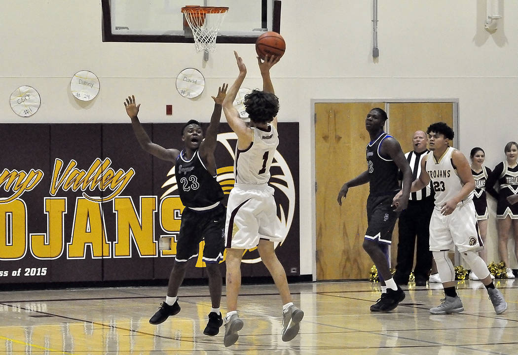 Horace Langford Jr./Pahrump Valley Times  Cory Bergan of the Pahrump Valley Trojans takes a shot against Desert Pines on Feb. 2 in Pahrump. The Trojans play at home on Friday against Western.