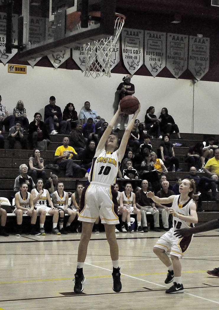 Horace Langford Jr./Pahrump Valley Times Samantha Runnion and Makayla Gent are shown in action on Feb. 2 at home against Desert Pines. The Trojans play host to Western on Friday night.
