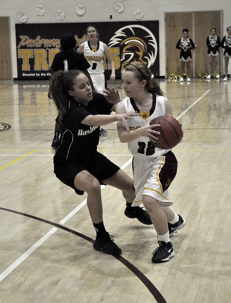 Horace Langford Jr./Pahrump Valley Times Makayla Gent works past a Desert Pines defender in a Feb. 2 game in Pahrump. The Trojans play again at home on Friday.