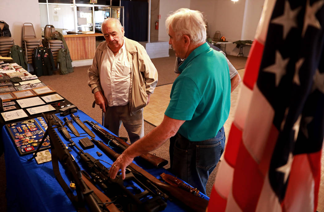 Veteran Robert Davison, right, shows Pete Stojanovich the different war memorabilia he owns during a 50th anniversary event remembering the Vietnam War Tet Offensive at the American Legion Vegas P ...