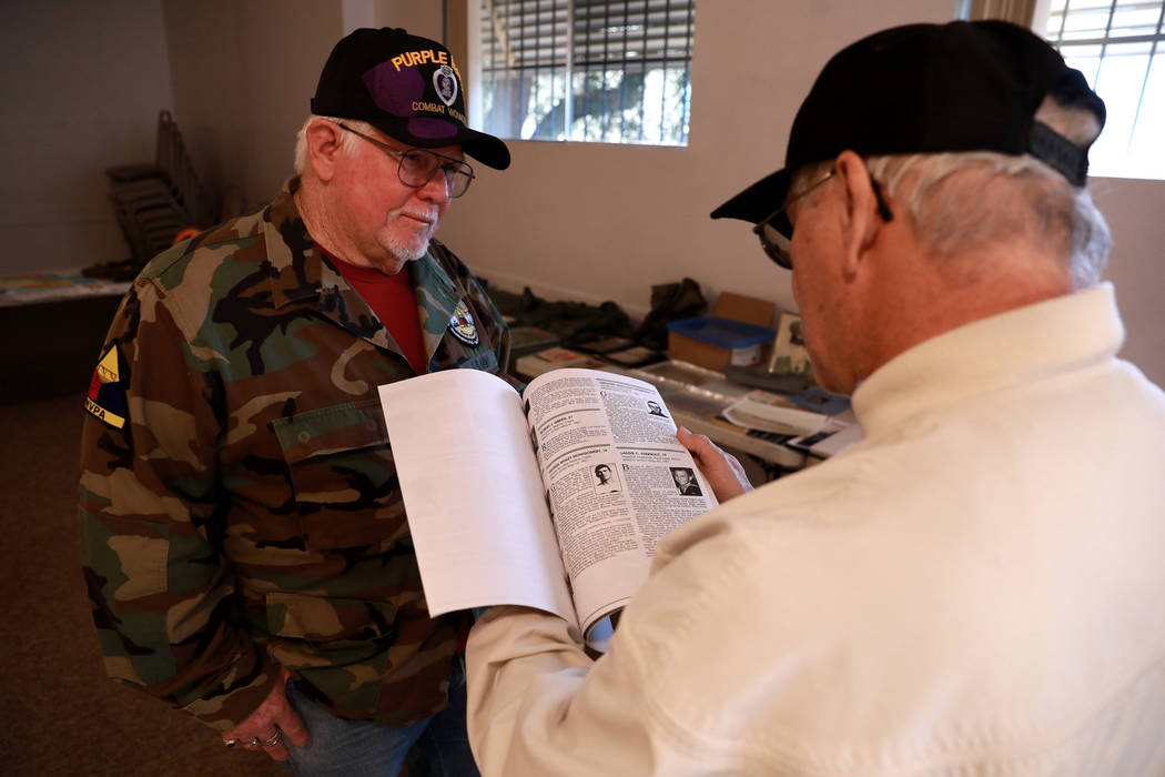 Veterans Bob Haygood, left, and Larry Hastings look at war memorabilia during a 50th anniversary event remembering the Vietnam War Tet Offensive at the American Legion Vegas Post 8 in Las Vegas, S ...