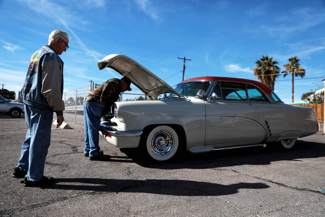 Veteran Frederick Raucci, left, shows Bob Haygood his 1952 Mercury Monterey during a 50th anniversary event remembering the Vietnam War Tet Offensive at the American Legion Vegas Post 8 in Las Veg ...