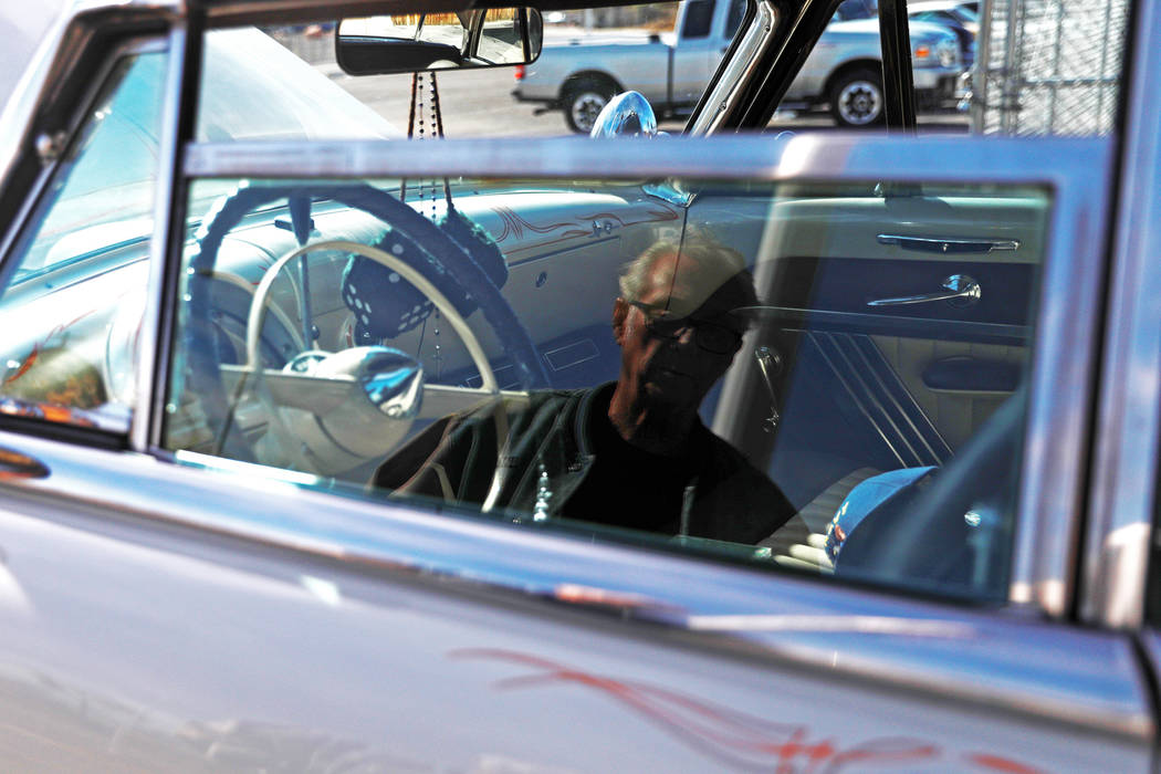 Veteran Frederick Raucci is reflected on his 1952 Mercury Monterey during a 50th anniversary event remembering the Vietnam War Tet Offensive at the American Legion Vegas Post 8 in Las Vegas, Satur ...
