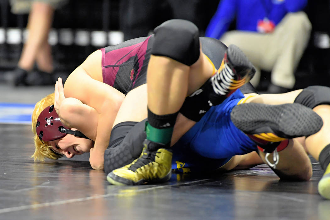 Peter Davis/Special to Pahrump Valley Times Freshman Dylan Wright of Pahrump Valley pinned Lowry's Andres Gonzalez in 20 seconds in the consolation final to claim third place at 145 pounds at the  ...