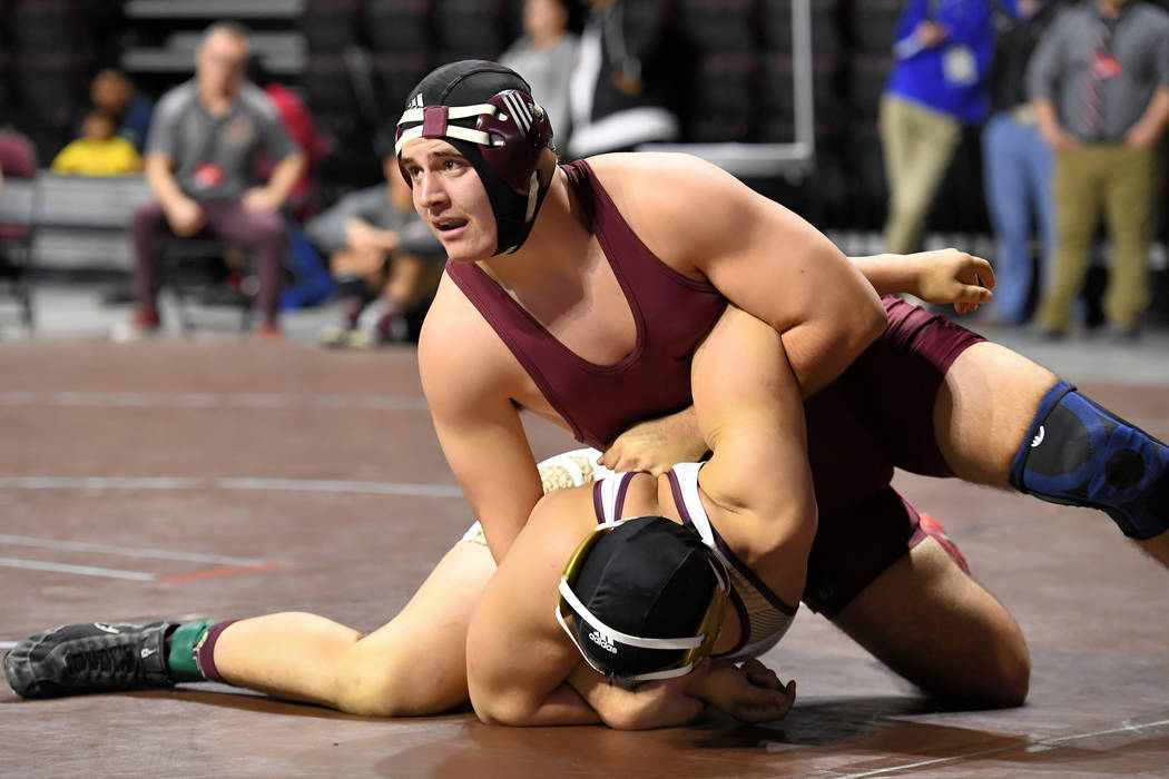 Peter Davis/Special to Pahrump Valley Times Pahrump Valley senior Morgan White pinned Julius Rice-Misa of Sparks in 3:06 to win the 220-pound championship at the state Class 3A wrestling champions ...