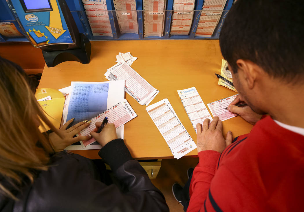 Richard Brian/Las Vegas Review-Journal  Customers make their picks before buying lottery tickets at The Lotto Store at Primm just inside the California border next to the Primm Valley Casino Resor ...