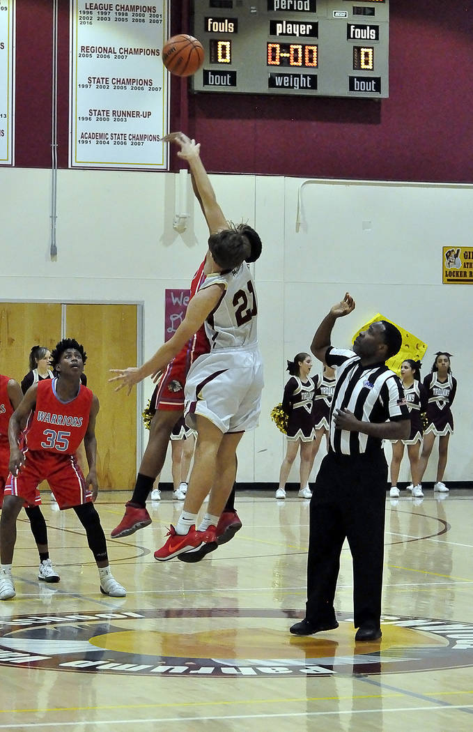 Horace Langford Jr./Pahrump Valley Times Pahrump Valley junior Brayden Severt goes up for the opening tip against Western during Friday's game in Pahrump.