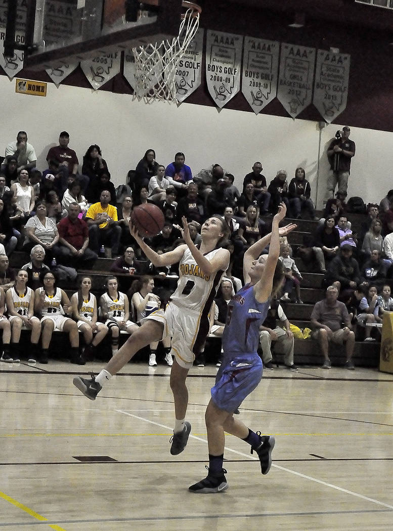 Horace Langford Jr./Pahrump Valley Times Senior Alyvia Briscoe drives to the basket against Western on Friday in Pahrump. Briscoe led all scorers with 16 points in the Trojans' victory.