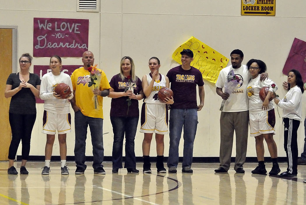Horace Langford Jr./Pahrump Valley Times Pahrump Valley girls basketball players, from left, Alyvia Briscoe, Jenna Broderick and Jessica Turner, and their parents were honored on Senior Night on F ...