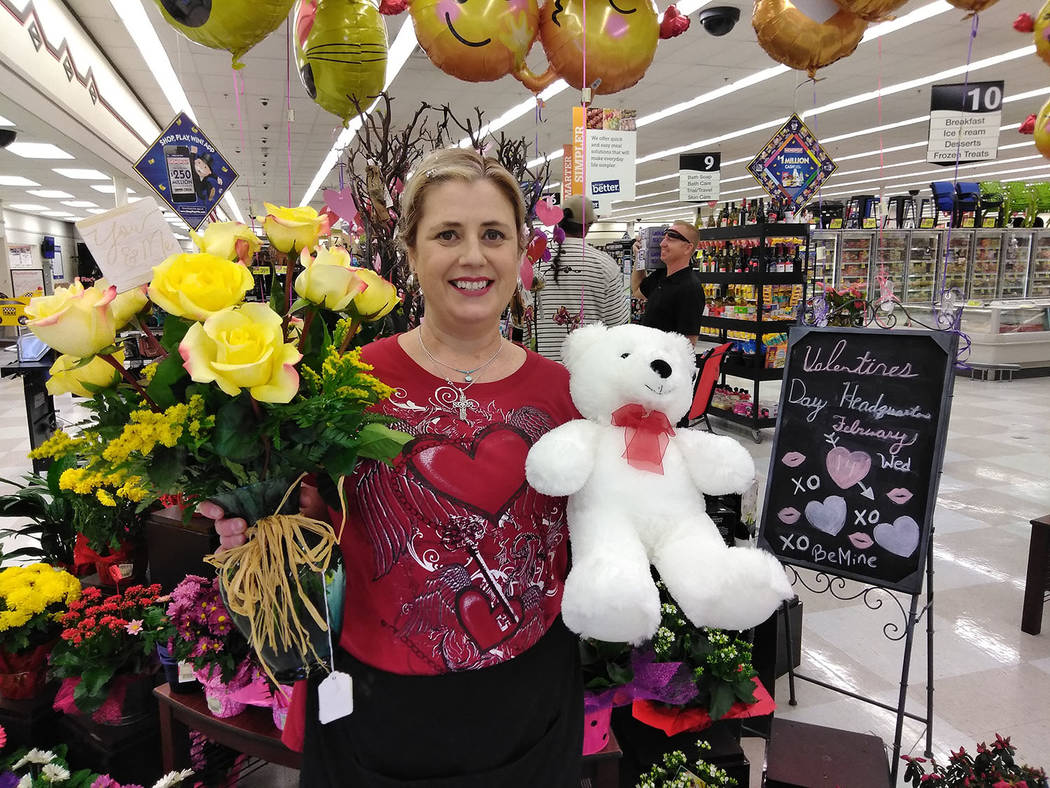 "Selwyn Harris/Pahrump Valley Times  Albertsons Supermarket Floral Supervisor Michelle Gleason refers to her department as the town's ""unofficial"" Valentine's Day headquarters. Gleason said ..."