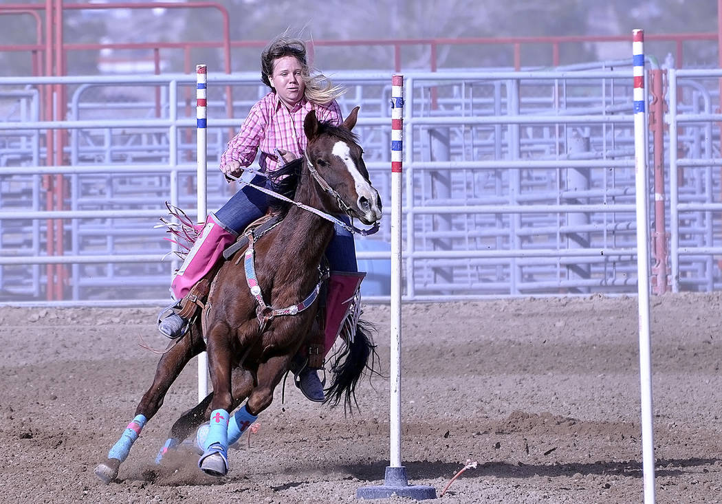 Horace Langford Jr./Pahrump Valley Times - Pole bending was yet another competition the youth were able to participate in. Karen Young is shown directing her horse through the obstacle.