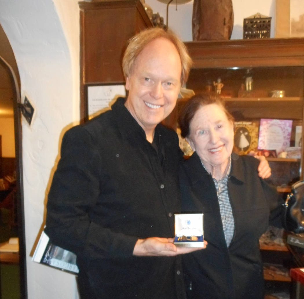 Fred Conboy and Lothian Skelton at the Amargosa Hotel. Conboy holds a pair of gold cufflinks the belonged to comedian Red Skelton, given to him by Lothian Skelton on the night of the 50th annivers ...
