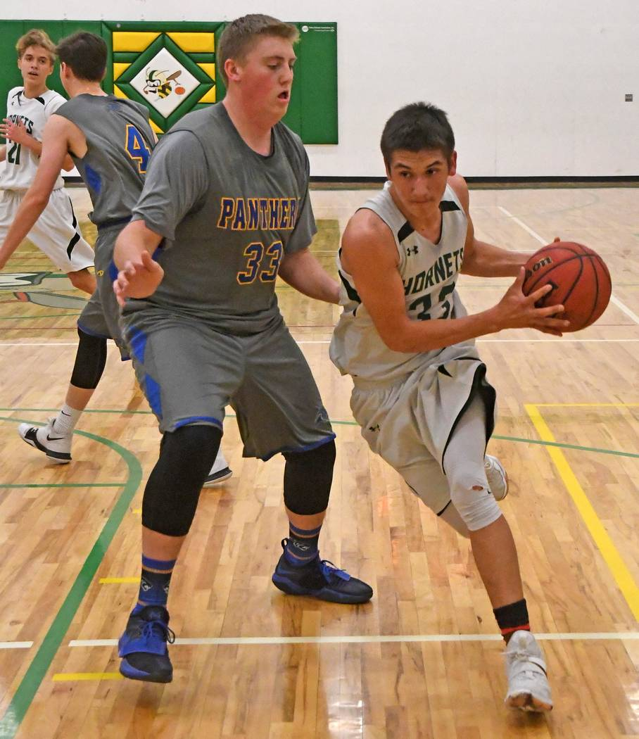 Richard Stephens/Special to Pahrump Valley Times Beatty sophomore Jose Granados looks to drive toward the basket against Pahranagat Valley during the Hornets' 51-26 defeat Feb. 2 in Alamo.