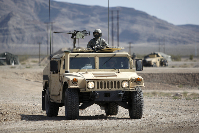 Erik Verduzco/Las Vegas Review-Journal A Nevada Army National Guard soldier keeps watch during a pre-deployment drill at the North Las Vegas Readiness Center as shown in a file photo. About 30 Nev ...