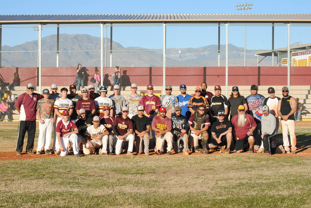 Charlotte Uyeno/Pahrump Valley Times  Participants in the annual Pahrump Valley alumni baseball game after the alumni team defeated the current Trojans 11-3 on Saturday, Feb. 17, at the high school.
