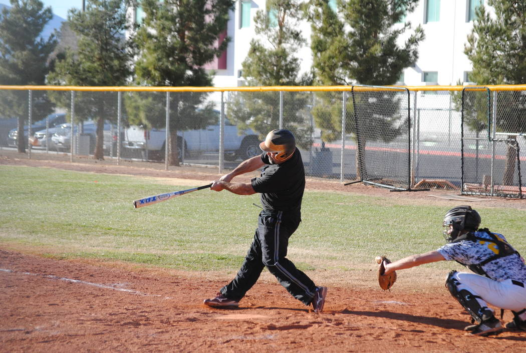 Charlotte Uyeno/Pahrump Valley Times Former Pahrump Valley baseball coach and athletic director Rich Lauver of the class of 1993 starts an eighth-inning rally with a double for the alumni team in  ...