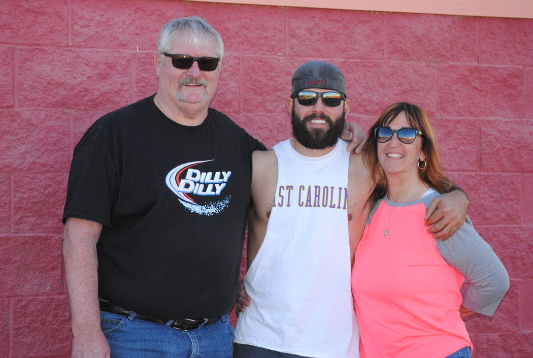 Charlotte Uyeno/Pahrump Valley Times  Cody Nielsen, a 2008 graduate of Pahrump Valley High School, with his parents Dennis and Diane after the Maroon and Gold alumni baseball game Saturday, Feb. 1 ...