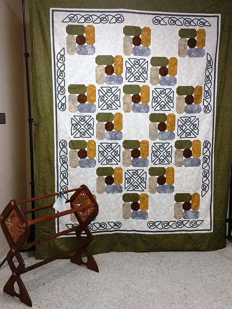 "Special to the Pahrump Valley Times The 2018 Pins and Needles Quilt Show Opportunity Quilt is based on the ""Celtic Cobblestone"" pattern. The quilt was crafted specifically to accompany the quilt r ..."