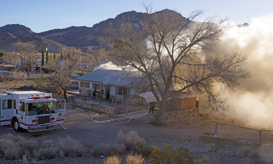 Richard Stephens/Special top the Pahrump valley Times The fire was evidently was started by old, faulty wiring and burned mostly in the attic area and completely destroyed the roof, rafters and tr ...