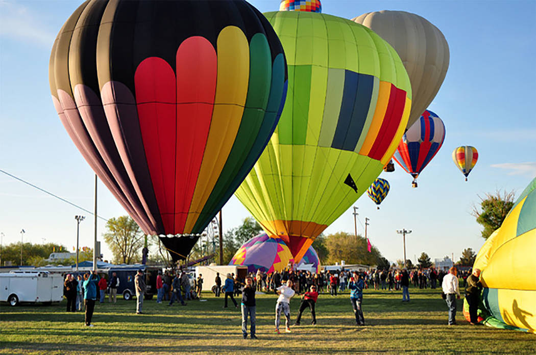 Selwyn Harris/Pahrump Valley Times More than two dozen balloonists are expected to participate in the 2018 Pahrump Balloon Festival at Petrack Park beginning on Friday. Though admission and parkin ...