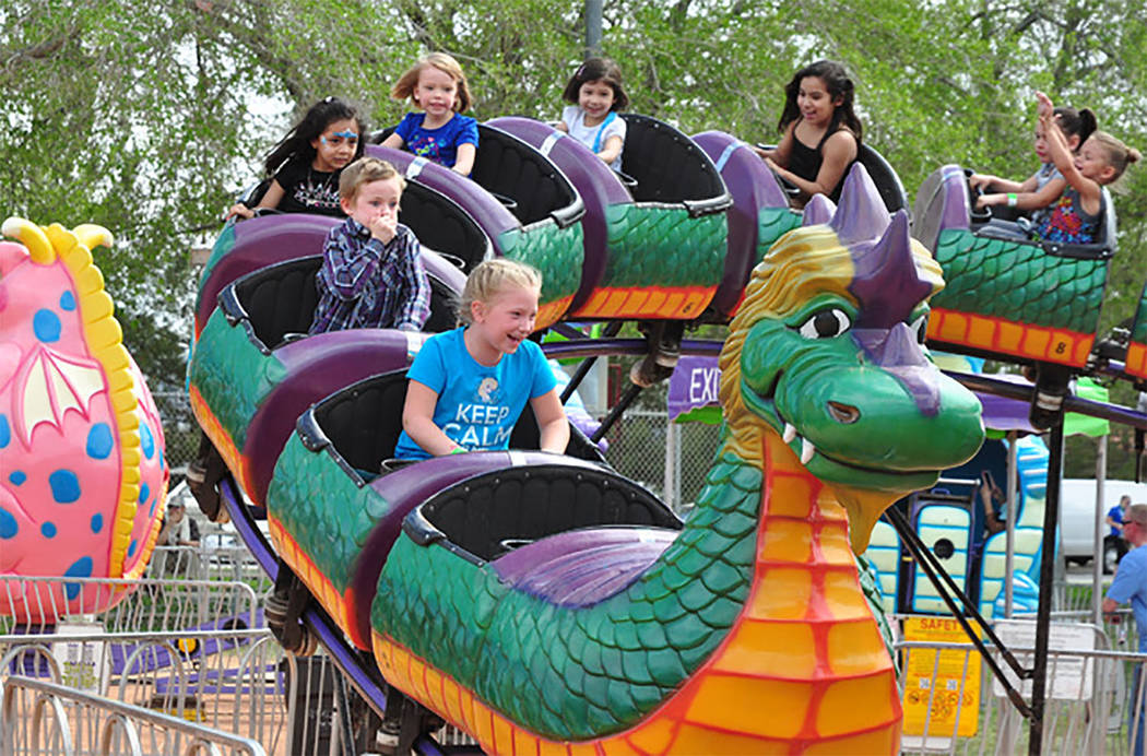 """Selwyn Harris/Pahrump Valley Times Pahrump's Davis Amusements are providing the carnival portion of the three-day balloon festival, complete with a """"Glow Show"""" and plenty of vendor booths at the p ..."""