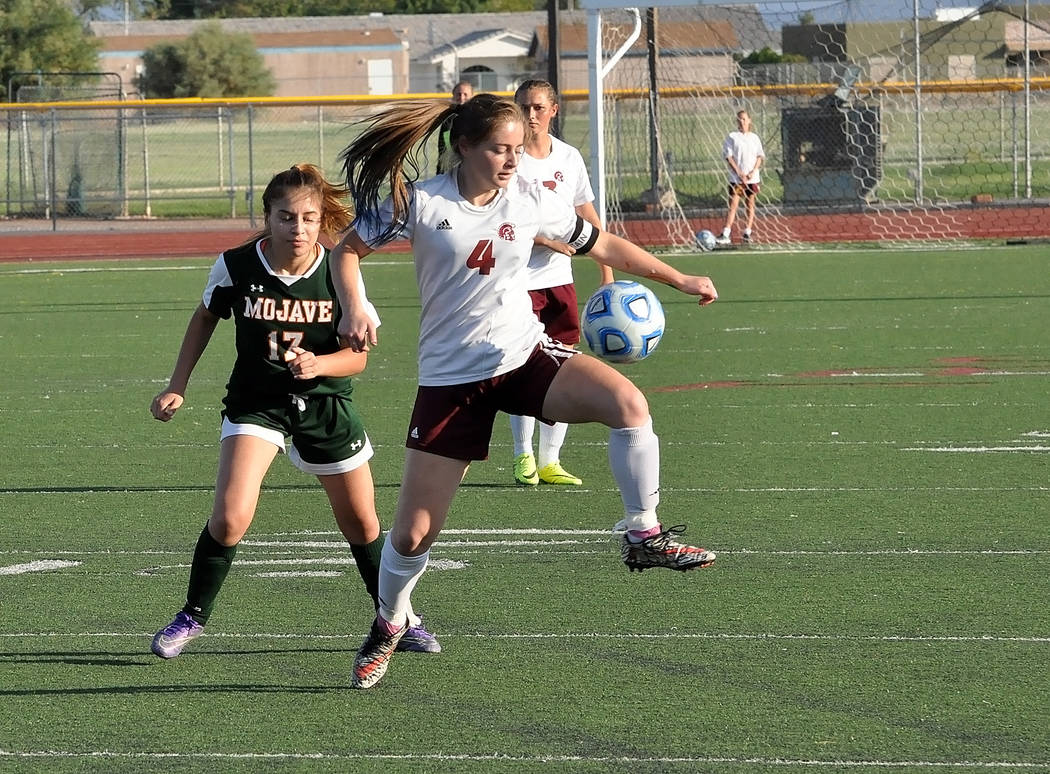 Horace Langford Jr./Pahrump Valley Times Senior Kathy Niles makes a great midair stop for the Trojans during the Mojave game. Niles had one assist and numerous shots on the goal on Wednesday.