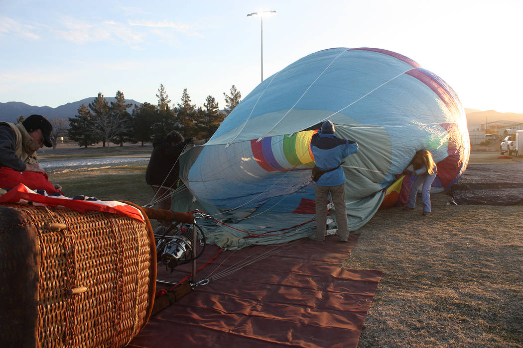 Robin Hebrock/Pahrump Valley Times A view of a balloon as crew members work to inflate the air craft. While two of the team held open the balloon, a high-powered fan started the inflation, which w ...