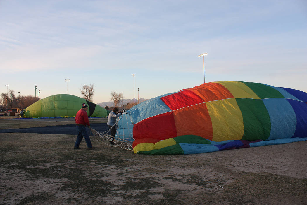 Robin Hebrock/Pahrump Valley Times Inflating a hot air balloon takes a lot of work and attention. Balloon crews must pay attention to all angles of the air craft to ensure proper no damage occurs  ...