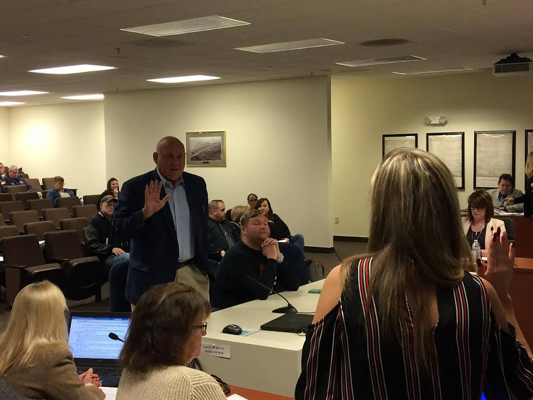 Robin Hebrock/Pahrump Valley Times Dennis Hof is shown being sworn in by Nye County staff. Those testifying in Hof's disciplinary hearing were required to take an oath to tell the truth, the whole ...