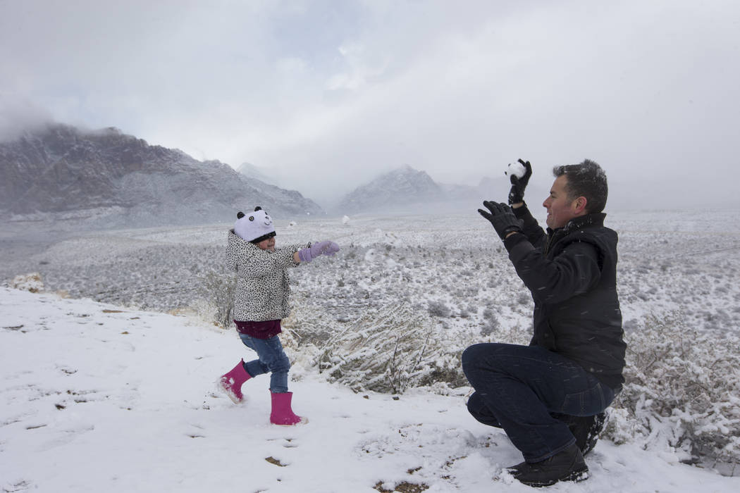 Danny Vasquez of Las Vegas and his daughter Nika, 4, play in the snow at Red Rock Canyon Overlook, Friday, Feb. 23, 2018 near Las Vegas. Richard Brian Las Vegas Review-Journal @vegasphotograph