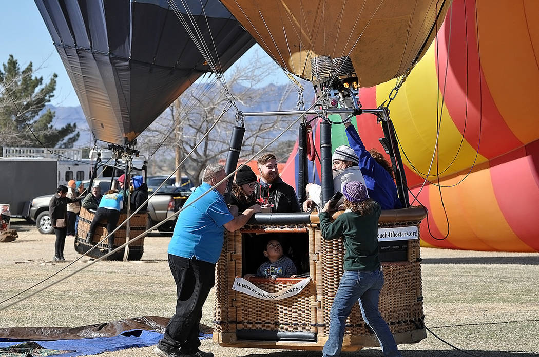 Horace Langford Jr./Pahrump Valley Times Volunteers were a valuable commodity as they helped to keep the balloons steady when gusty conditions set upon the valley during the three-day balloon fest ...