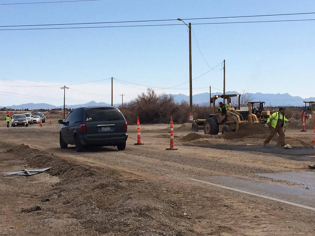 Robin Hebrock/Pahrump Valley Times The roadwork at Homestead Road and Gamebird Road has been causing minors traffic delays this week. Drivers can be seen in the background, awaiting their turn to  ...