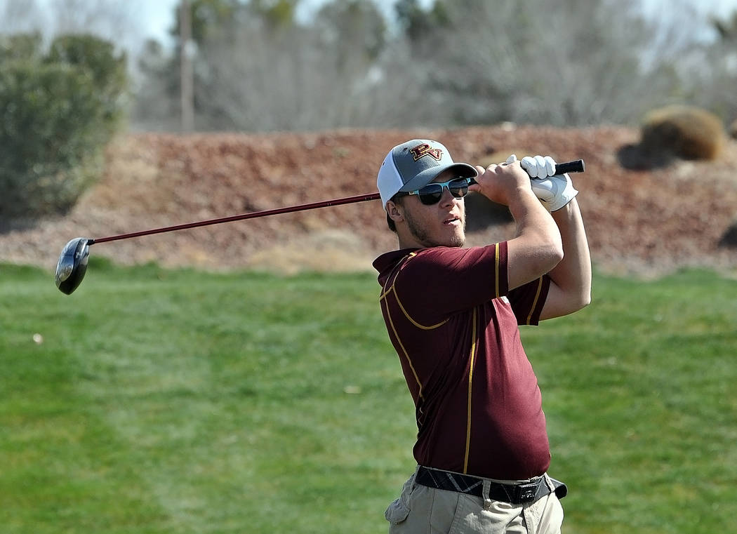 Horace Langford Jr./Pahrump Valley Times Pahrump Valley sophomore Haden Wray follows the flight of his tee shot Thursday, March 8, during the first round of the Pahrump Valley Invitational at Moun ...