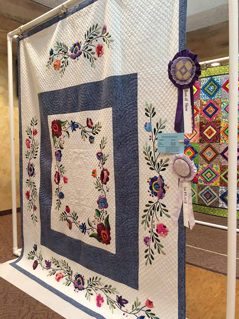 "Robin Hebrock/Pahrump Valley Times The 2018 Pins and Needles Quilt Show Best in Show winner was this quilt, titled ""Almost Crewel"" and crafted by Shirley Pierce. She said this project, started in  ..."