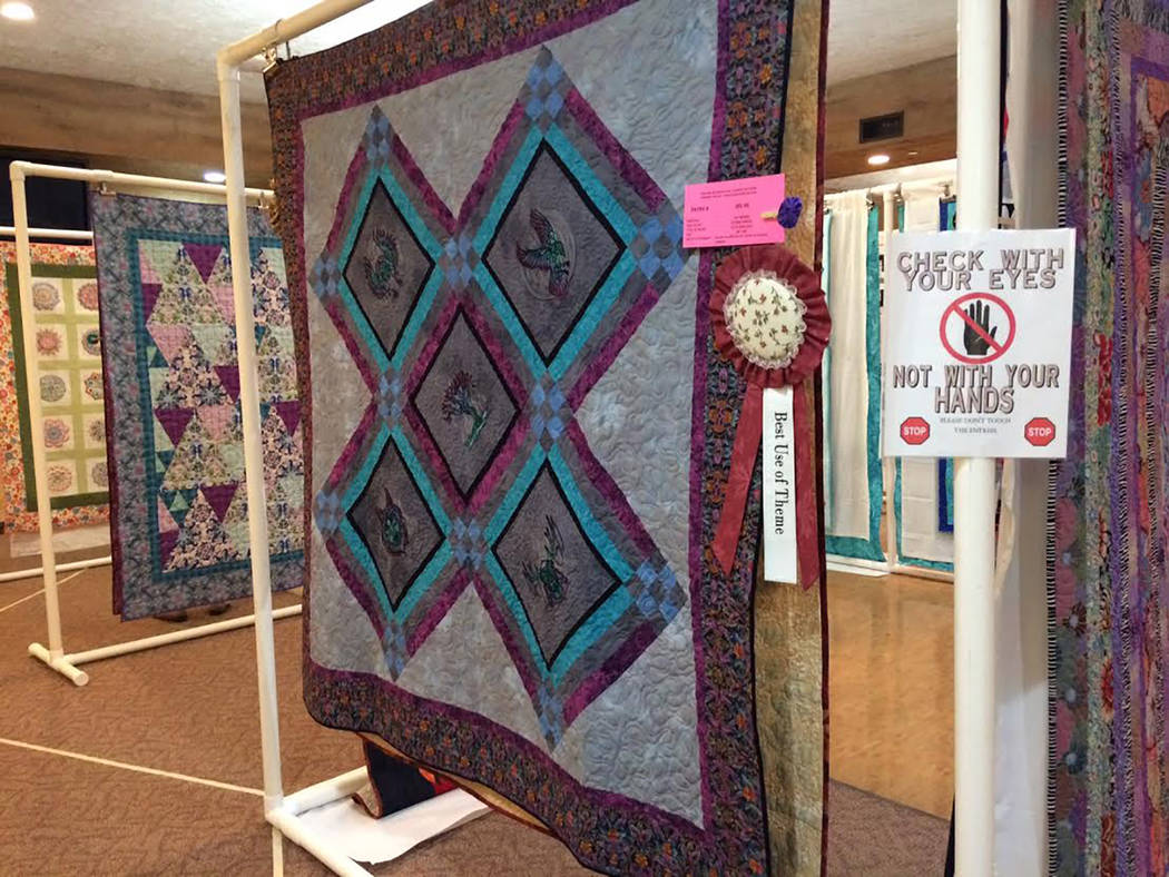 "Robin Hebrock/Pahrump Valley Times This quilt, entitles ""Celtic Gone Wild,"" was made by Pat Wyman and quilted by Victoria Brazzel. It took home first place for Best Use of Theme."