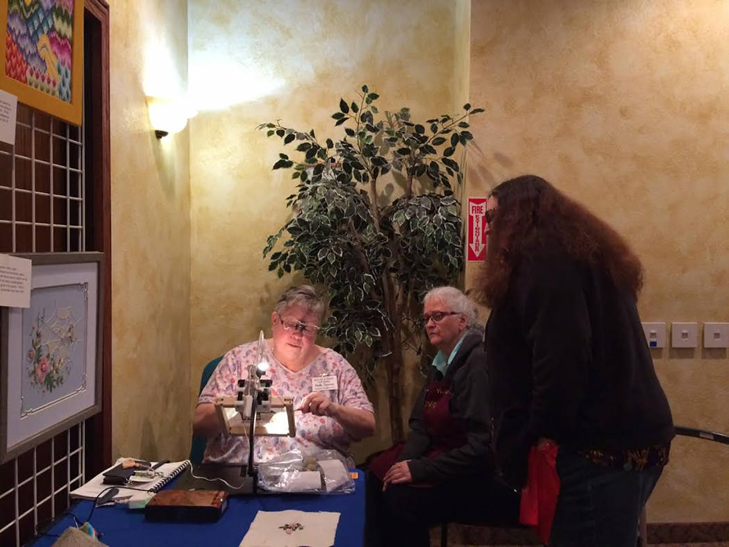 Robin Hebrock/Pahrump Valley Times Featured needleworker Vicki Texeira spent much of the Pins and Needles Quilt Show teaching patrons tips and techniques for creating needlework masterpieces. She  ...