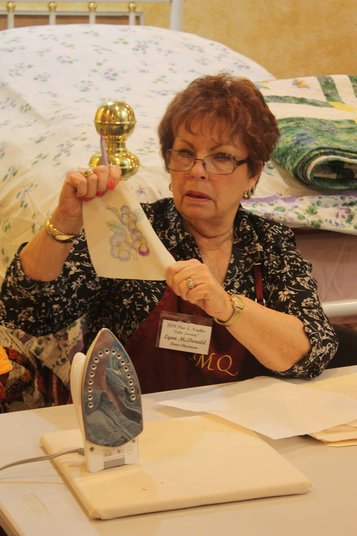 Robin Hebrock/Pahrump Valley Times Lynn McDonald was just one of many individuals to lend her talents to the Pins and Needles Quilt Show. She is pictured teaching attendees during a demonstration  ...