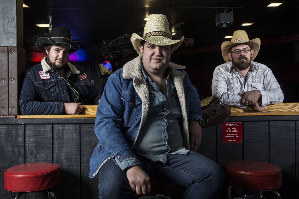 The Reeves Brothers, an ameripolitan country music band from Pahrump. From left: Cole Reeves, Matt Reeves and Kelly Bishop on Wednesday, February 21, 2018, at Saddle N Spurs Saloon, in Las Vegas.  ...