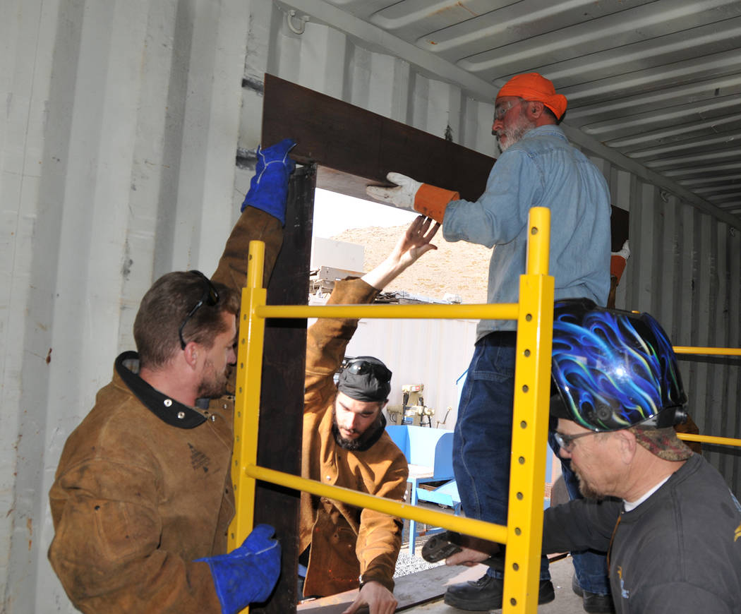 Western Nevada College From left, Michael Varner, Charles Carnevale and Eric Forstrom assist Masih Madani, top right, put in a window frame on the home he isbuilding out of a shipping container as ...