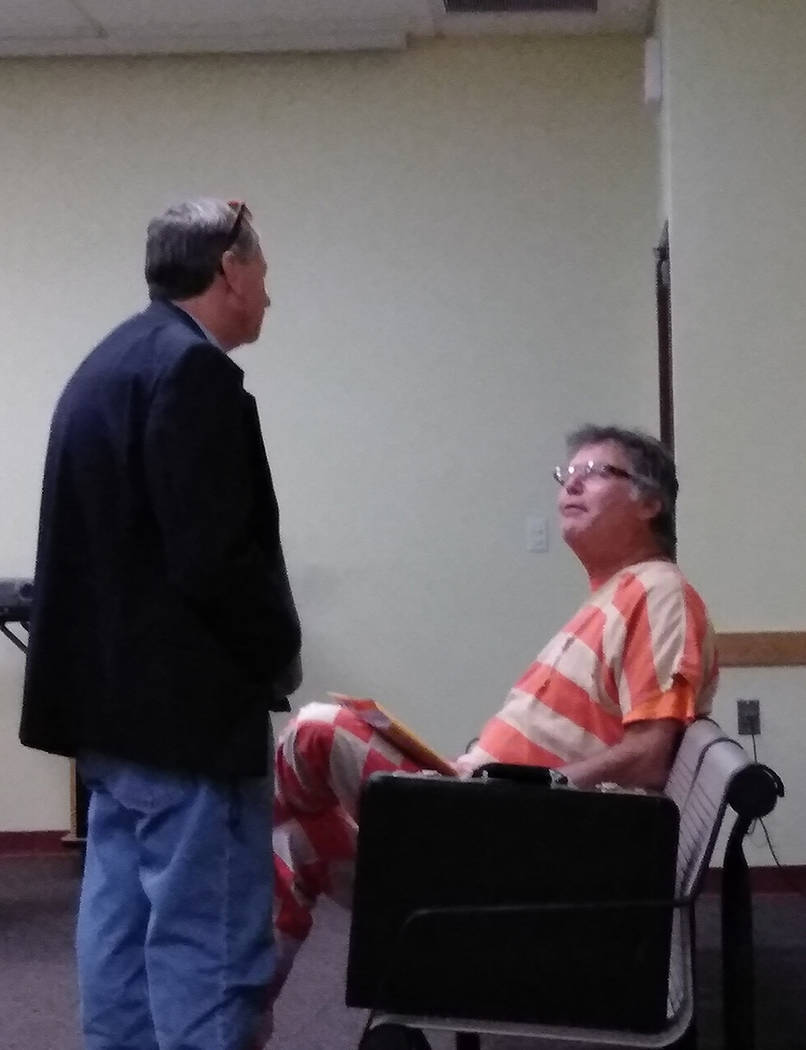 Selwyn Harris/Pahrump Valley Times Pahrump Justice of the Peace candidate Richard Hamilton, in custody and seated, speaks to defense attorney David Neely III prior to his court hearing on Monday F ...