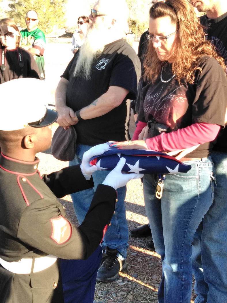 Selwyn Harris/Pahrump Valley Times A Marine Corps Honor Guard from Las Vegas presents the American flag to Joanna Dawn Karle, daughter of longtime Pahrump veteran Bernard M. Mihalcean, 65, who pas ...